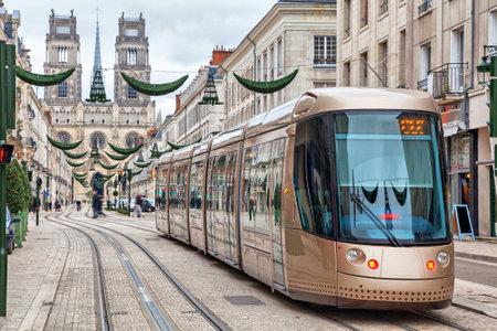 Brown tram on Rue Jeanne dArc in Orleans, France Editorial