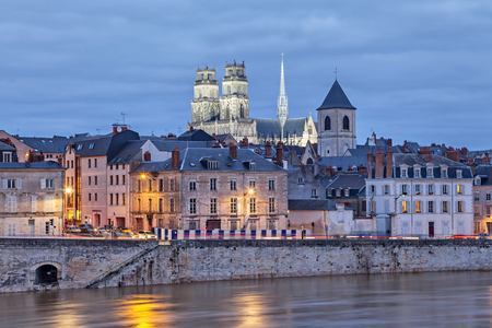Embankment of Loire river and Orleans Cathedral in the evening, Orleans, France