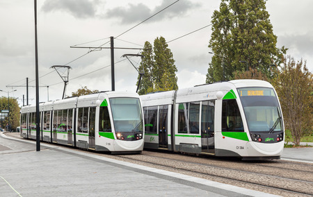 public transport: Nantes, France - October 07, 2014: Two modern white-green trams in Nantes, France