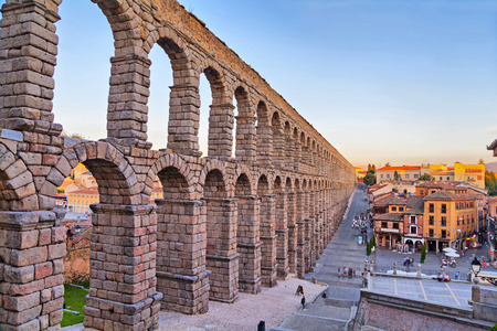 castile leon: Ancient Roman aqueduct on Plaza del Azoguejo square in Segovia Spain