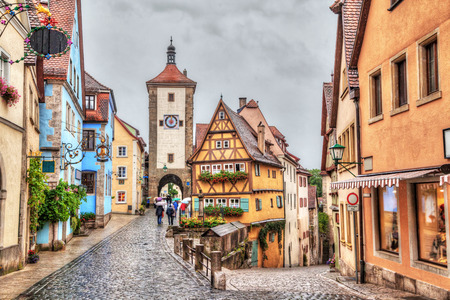 der: Picturesque view of medieval town Rothenburg ob der Tauber in rainy weather with HDR effect Bavaria Germany Stock Photo