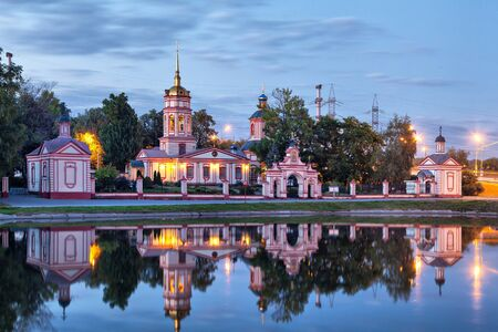 exaltation: Historical Altufevo estate reflectiong in water in the evening, Moscow, Russia