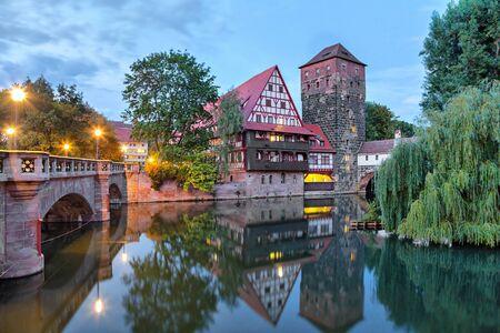 Maxbrucke bridge and Henkerturm tower - part of western medieval fortifications of Nuremberg Standard-Bild