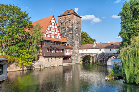 tower house: Traditional half-timbered house and Henkerturm tower - part of western medieval fortifications, Nuremberg, Germany