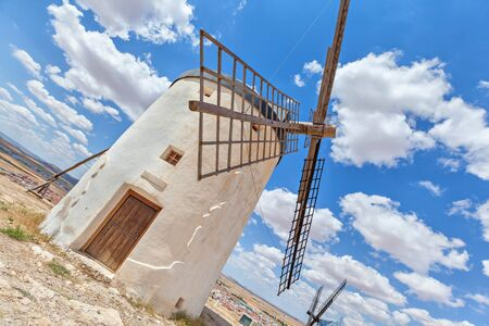 unusual angle: One of the famous windmills in Consuegra viewed by unusual angle, Toledo province, Spain