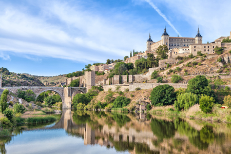 View on Puente de Alcantara and Alcazar de Toledo from side of Tagus river, Toledo, Spain