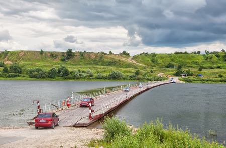 mongols: Russia, Spassk-Ryazansky - June 11 2015: Cars on pontoon bridge across the Oka River in the area of the settlement of the old Ryazan, ruined by Mongols in 1236 Editorial