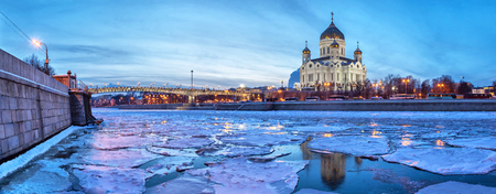 Panoramic image of Moscow River neat Christ the Savior Temple with floe in the winter evening, Moscow, Russia