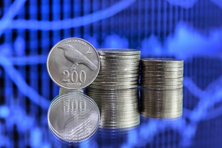 rupiah: 200 Indonesian Rupiah coin on blue background Stock Photo