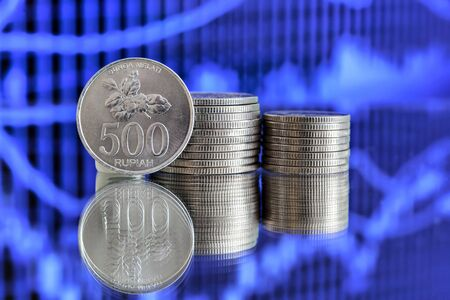 silver reflection: 500 Indonesian Rupiah coin on blue background