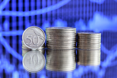 rupiah: 50 Indonesian Rupiah coin on blue background Stock Photo