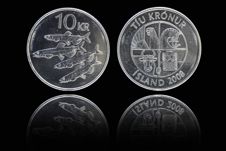 an obverse: Obverse and reverse of 10 icelandic krona coin on black background