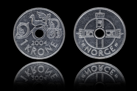 an obverse: Obverse and reverse of one Norwegian krone coin on black background