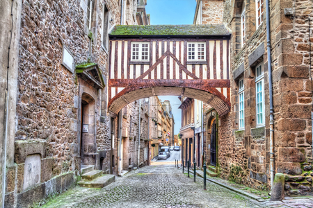 half timbered: Wooden brigde between two buildigs on narrow street in Saint-Malo, Brittany, France