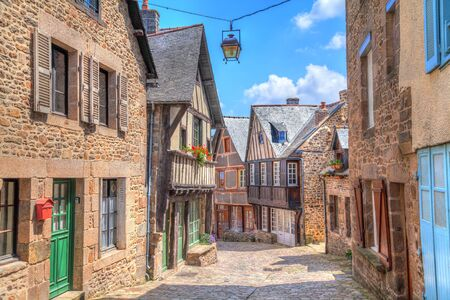 dinan: Narrow street with old traditional houses in histoical part of Dinan, Brittany, France