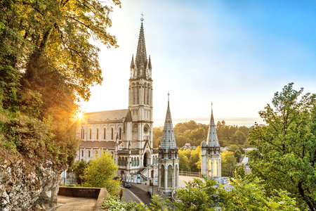Rosary Basilica on sunset in Lourdes, Hautes-Pyrenees, France