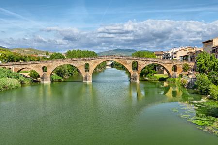 touristic: Ancient roman bridge across the Arga river in Puente la Reina, near Pamplona, Navarra, Spain
