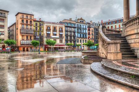 Colorful houses on Plaza del Castillo in rainy day, Pamplona, Navarra, Spain