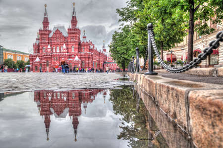 historical reflections: Moscow, Russia - June 09 2016: Building of Historical museum reflecting in pudle on the Red Square