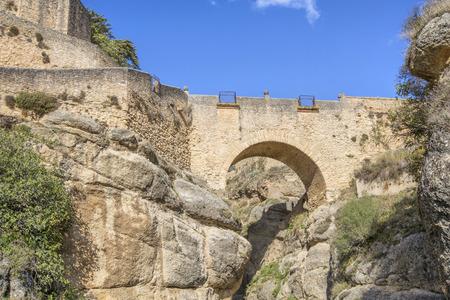 historical landmark: Puente Viejo bridge in Ronda, Andalusia, Spain Stock Photo