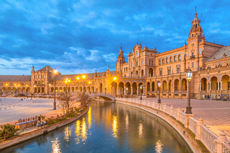 destination scenics: Canal and bridge reflecing in water on Plaza de Espana in the evening, Seville, Andalusia, Spain Stock Photo