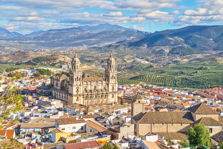 Aerial cityscape of Jaen with cathedral and Sierra Magina mountains on background, Andalusia, Spain