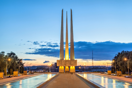 worl: Illuminated Worl War II memorial on Victory square in the center of the Vitebsk at dusk, Belarus Stock Photo