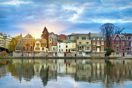 belgique: Old buildings on the bank of Meuse (Maas) river on sunrise in Namur, Wallonia, Belgium (colorful HDR image) Stock Photo