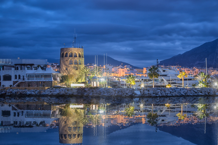 Tower in Puerto Banus at dusk in Marbella, Andalusia, Spain Stock Photo