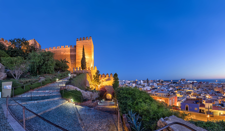illuminated: Panoramic view on city skyline and walls of Alcazaba fortress in Almeria, Andalusia, Spain