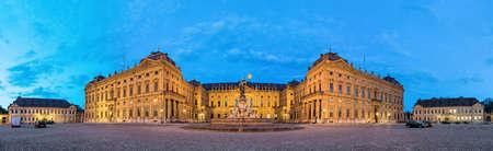 residenz: Panoramic view of illuminated Wurzburg Residence palace from Residenzplatz square in the evening, Wurzburg, Germany