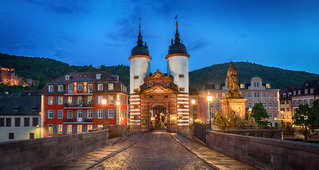 Illuminated Old Bridge Gate on Karl Theodor Bridge in Heidelberg, Baden-Wurttemberg, Germany