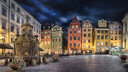 residential: Stortorget square with colorful couses in the center of Old Town (Gamla Stan) of Stockholm, Sweden at dusk Stock Photo