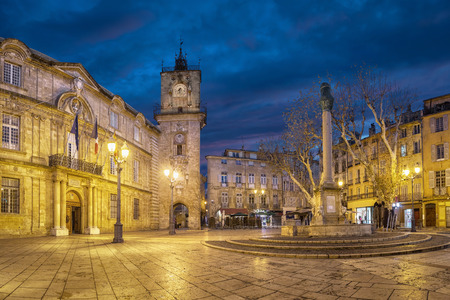Town Hall square at dusk with City Hall (Hotel de Ville) building, clock tower and fountain in Aix-en-Provence, France