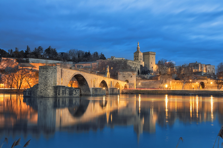 View on Pont d'Avignon 12th century bridge and city skyline reflecting in water at dusk in Avignon, Provence, France Stock fotó
