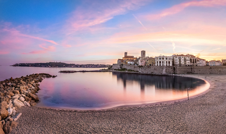Panoramic view of Antibes on sunset from Plage de la Gravette, French Riviera, France 스톡 콘텐츠