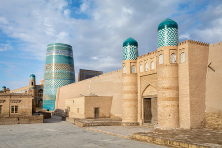 Gate of Kunya-Ark citadel and Kalta Minor minaret in Khiva, Khorezm Region, Uzbekistan Stock Photo