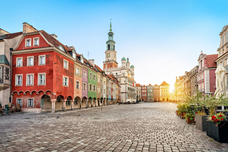 Stary Rynek square with small colorful houses and old Town Hall in Poznan, Poland