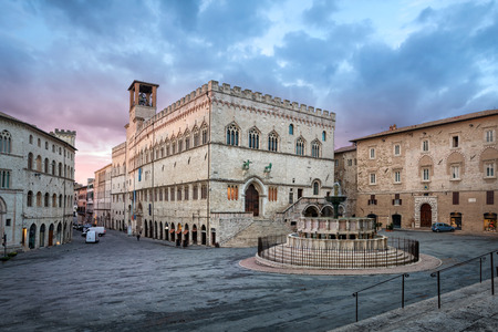Perugia, Italy. Piazza IV Novembre on sunrise with Old Town Hall and monumental fountain Fontana Maggiore
