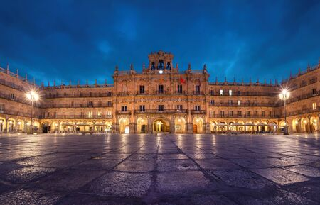 Salamanca, Spain. View of Plaza Mayor at dusk - 18th-century Spanish baroque public square bordered by shops, restaurants and Town Hall.