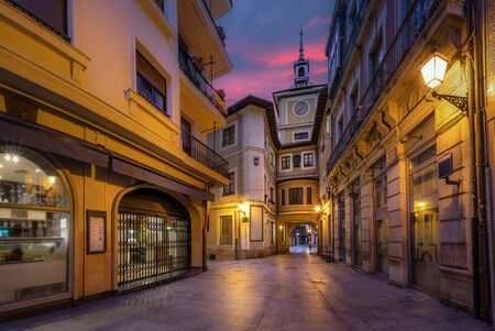 Oviedo, Spain. Clock Tower of Town Hall at dusk