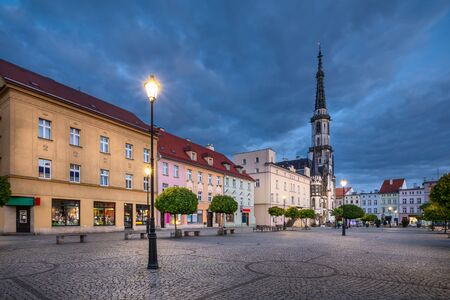 Zabkowice Slaskie, Poland. View of market square at dusk with old colorful houses and building of historic Town Hall