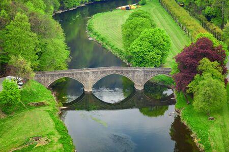 Bouillon, Belgium. High angle view of arch stone bridge Pont de Cordemoy over Semois river