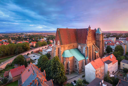 Strzegom, Poland. Aerial view of Saints Peter and Paul Basilica on sunset