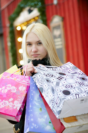Upset girl with shopping bags on the street photo