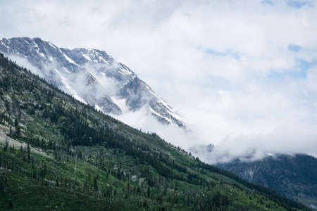 Glacier National Park: Cloud into the mountains at Glacier national park Stock Photo