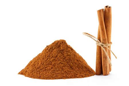 antiviral: Ground cinnamon powder and sticks on white isolated background