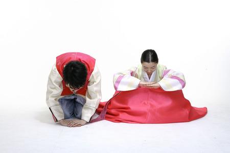 bowed head: Couple in Korean Dress