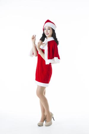 Portrait of Beautiful Asian Woman Wearing ChristmasSanta Costume