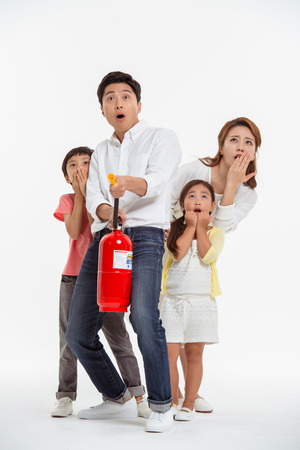 extinguishing: Asian Family Portrait  Isolated on White
